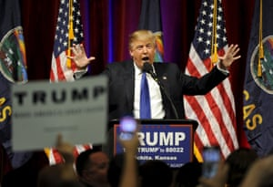 Donald Trump shows his hands during a rally before the Kansas Republican Caucus in Wichita, Kansas.
