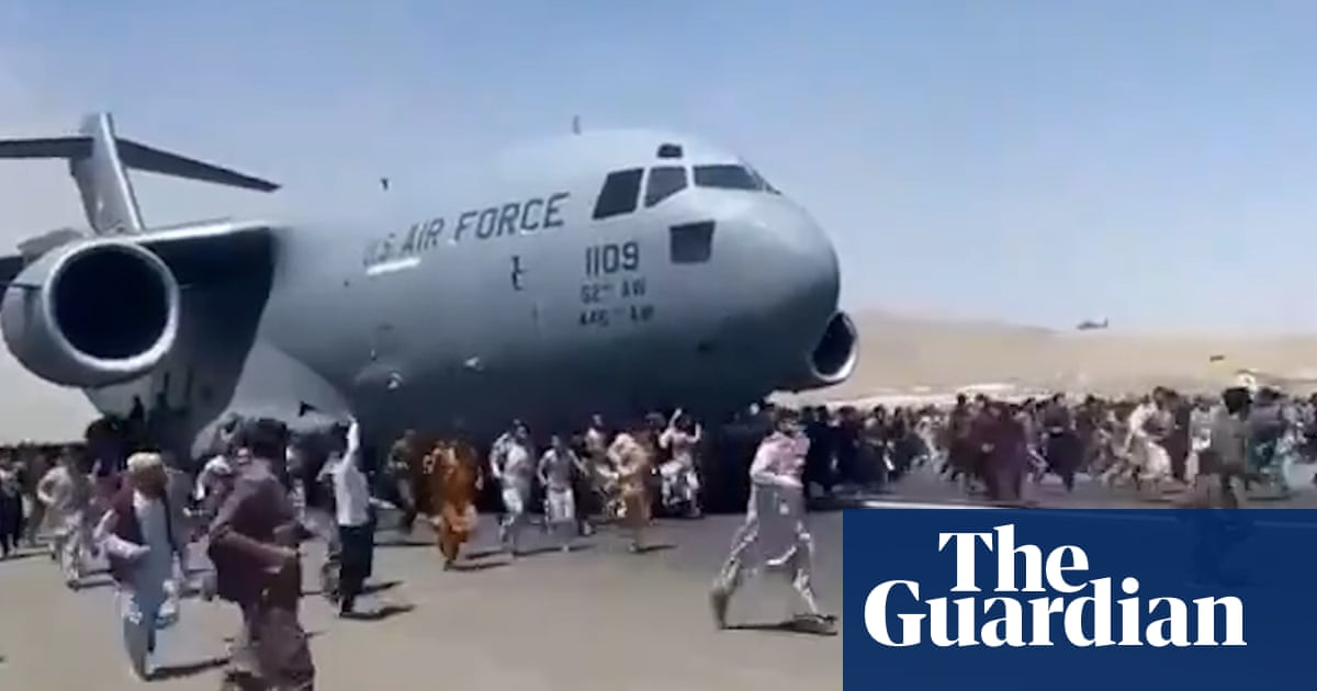 Afghans climb on to plane during takeoff in attempt to flee Taliban – video