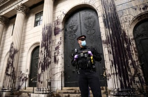 A police officer stands outside the Bank of England building