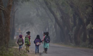 Indian children make their way to school on the outskirts of Gauhati in north-west India.