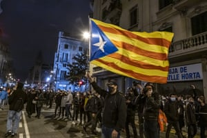 A protester waves a pro-Catalan independence flag in Barcelona