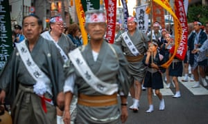 People march in Tokyo as part of the Torikoe-jinja shrine's annual June festival.