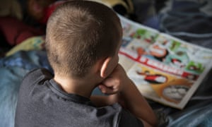A young boy reading a book