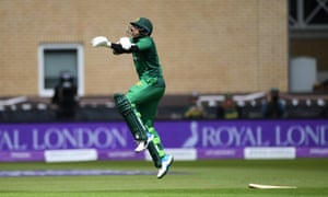 Pakistan batsman Imam-ul-Haq reacts after taking a blow on the elbow.