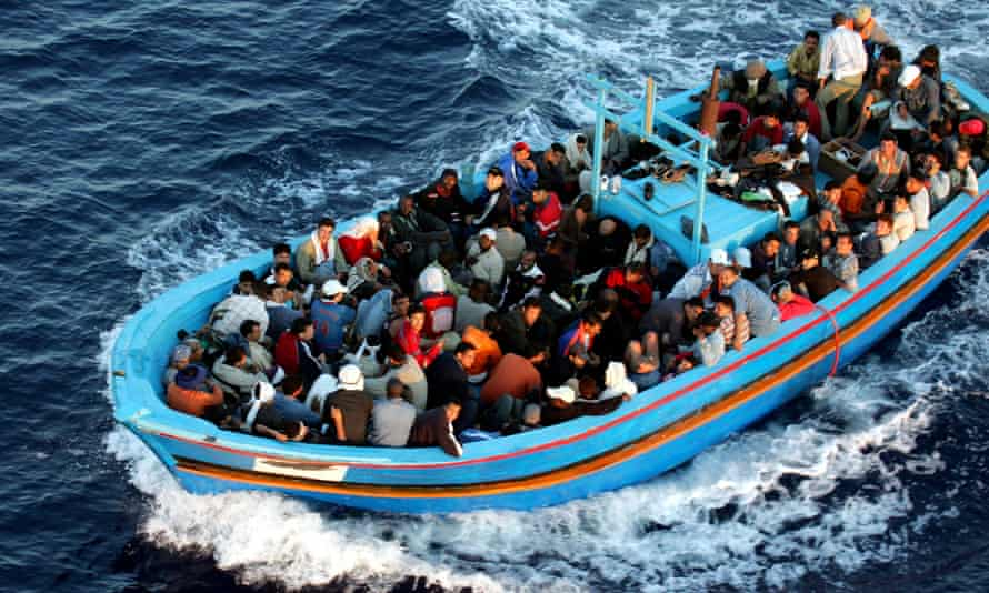 A boat full of migrants near Lampedusa, where in October 2013 a local optician, Carmine Menna, pulled drowning people from the sea