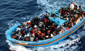 Refugees on a boat arrive in Lampedusa, Italy