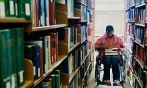 Student in wheelchair at library
