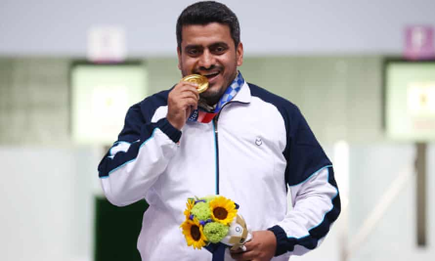 Iran's Javad Foroughi with his gold in the 10-metre air pistol event