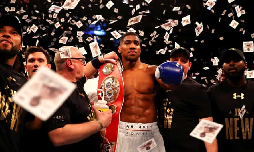 On a high: Joshua celebrates after defeating Charles Martin to take the IBF Heavyweight title on 9 April 2016.
