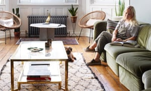 Ocean wave: Wendy Aldridge on her centrepiece sofa in the living room, with Pablo the border terrier.