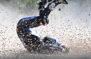 Spanish rider Maverick Vinales rolls on the ground after he crashed during the first training session ahead of the Moto GP at the Masaryk circuit in Brno.