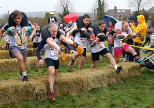 Surrey, UKCompetitors take part in the annual UK Wife Carrying Race at The Nower in Dorking.