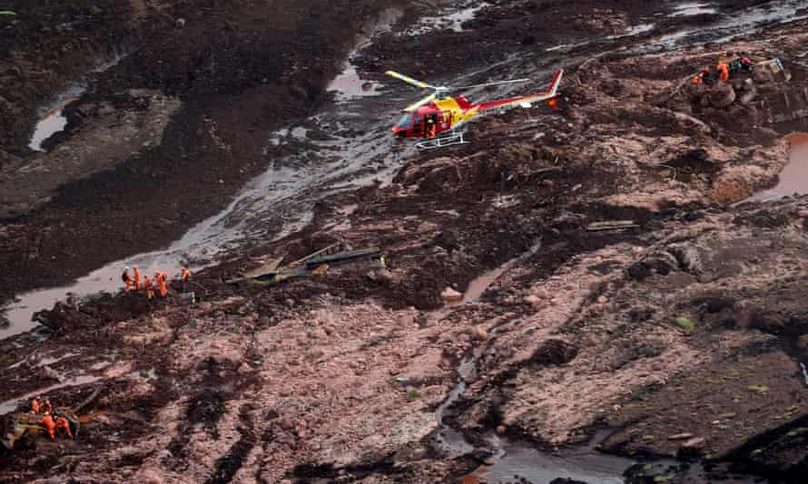 Firemen search for people after the dam collapse  unleashed a torrent of mud.