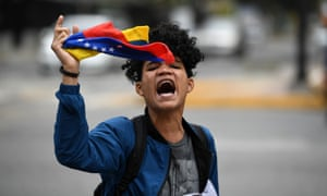 An opponent of Nicolás Maduro demonstrates in Caracas, Venezuela, on 4 May.