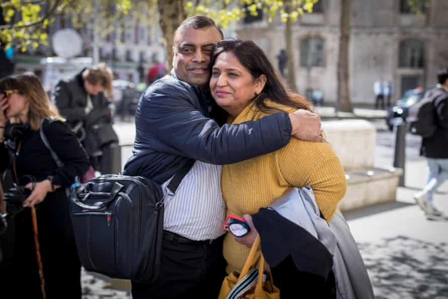Seema Misra, a former post office operator, with her husband, Davinder, outside the Royal Courts of Justice, London. She has been cleared of theft from the Post Office after being convicted and jailed in 2010.