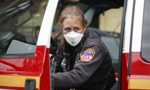 A Fire Department of New York (FDNY) medical worker wears personal protective equipment outside a COVID-19 testing site at Elmhurst Hospital Center, in the New York city borough of Queens yesterday. State governor Andrew Cuomo is warning things will get worse before they get better.