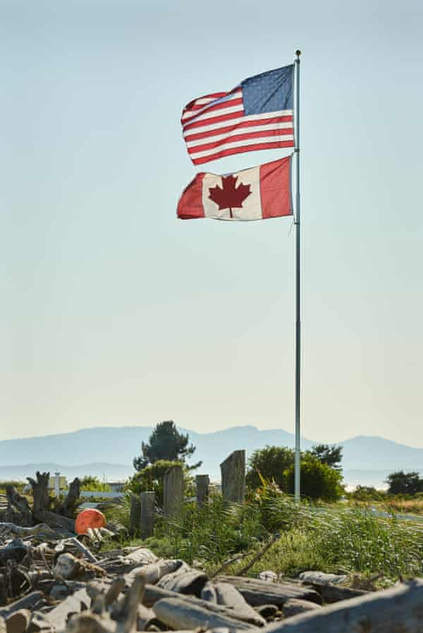The US and Canadian flags fly in Point Roberts.