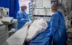 Placing the body of a deceased patient in a body bag. Perhaps the hardest of all jobs a nurse is required to do, but one always carried out with the utmost respect and dignity.