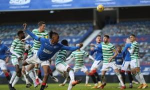 Rangers' Joe Aribo in action as Celtic's Callum McGregor scores an own goal.