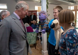 The Prince of Wales meets puppeteers Adam and Sharon Pinder during the opening of the Dorchester Community Church in Poundbury