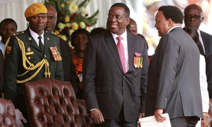 Emmerson Mnangagwa, centre, takes his seat at his presidential inauguration ceremony in Harare, Zimbabwe