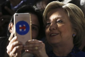 Hillary Clinton takes a photo with attendees during a campaign stop at City Hall in Philadelphia.