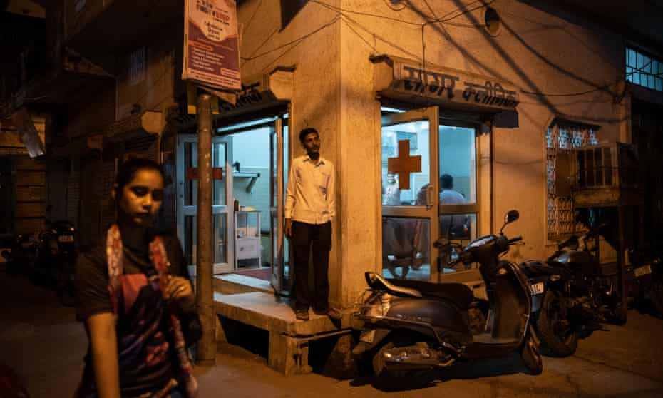 A man stands outside Sunil Sagar's clinic, which caters to local population of Bhagwanpur Khera, New Delhi, India. The patient can consult Dr Sagar at a nominal fee of 70 INR ($1 approximately).