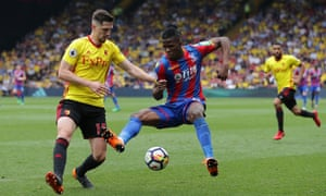 Crystal Palace's Wilfried Zaha is challenged by Craig Cathcart of Watford.