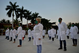 In this file photo taken on 28 March, 2020 doctors and nurses of Cuba's Henry Reeve International Medical Brigade take part in a farewell ceremony before travelling to Andorra to help in the fight against the coronavirus pandemic, at the Central Unit of Medical Cooperation in Havana.