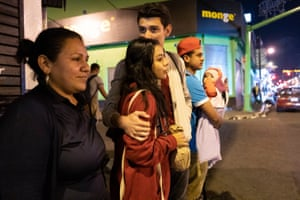 María Alejandra Castillo, 20, with her mother, boyfriend and other family members in downtown San José