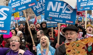 Thousands of people attend a rally in front of Downing Street to protest against underfunding and privatisation of the NHS