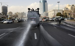 A police vehicle disinfects streets against coronavirus in Tehran.