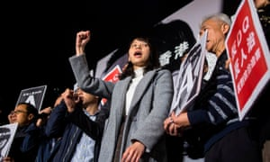 Pro-democracy activist Agnes Chow protests outside government offices in Hong Kong