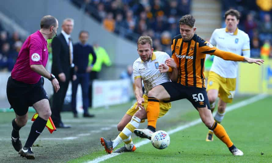 Angus MacDonald (right) in action against Sheffield Wednesday in April 2018.