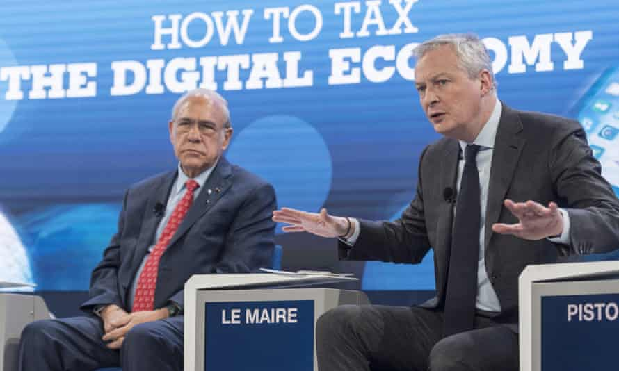 Ángel Gurría and French finance minister Bruno Le Maire at the World Economic Forum in Davos on Friday.