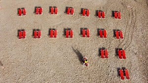 This aerial view shows a view of lounge chairs laid out on a beach in the Israeli Mediterranean coastal city of Tel Aviv, as beaches open for the first time after two months of confinement.