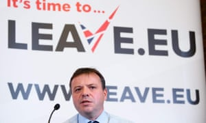 Arron Banks speaking in front of Leave.EU sign