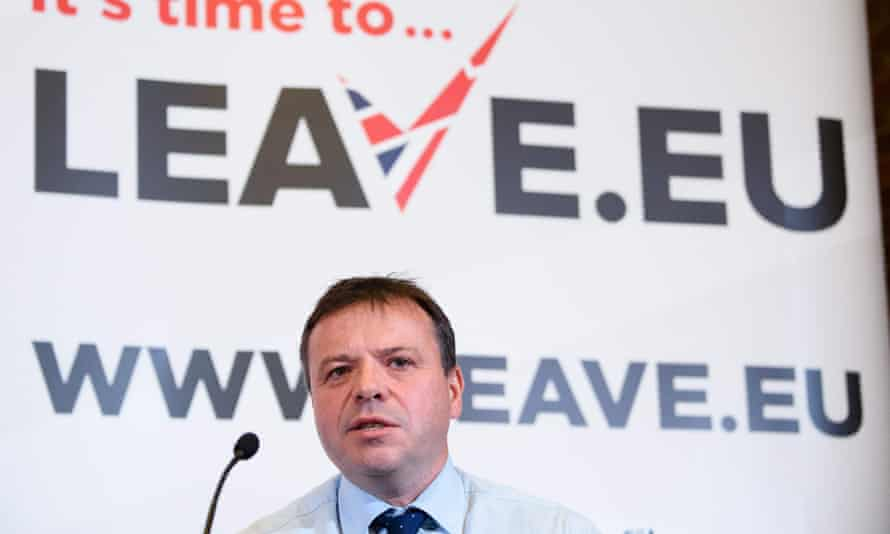 Arron Banks in front of a Leave.EU sign
