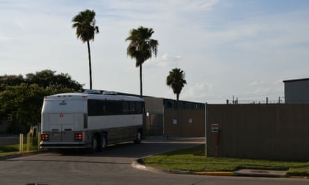 A migrant transport bus pulls into the US border patrol processing center in McAllen, Texas.