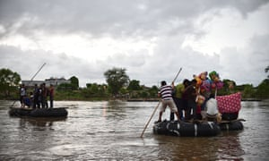 Migrants use a makeshift raft to cross the Suchiate river, natural border between Mexico and Guatemala, in Ciudad Hidalgo, Chiapas state, Mexico.