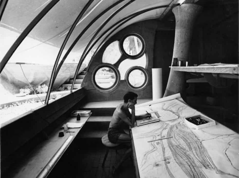 Architect Paolo Soleri in the drafting room at Cosanti during the mid 1960s, working on one of his scroll drawings
