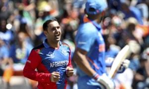 Afghanistan's Mohammad Nabi celebrates the dismissal of India's captain Virat Kohli,
