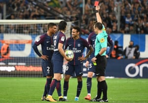Neymar laughs sarcastically as he is sent off in Marseille.