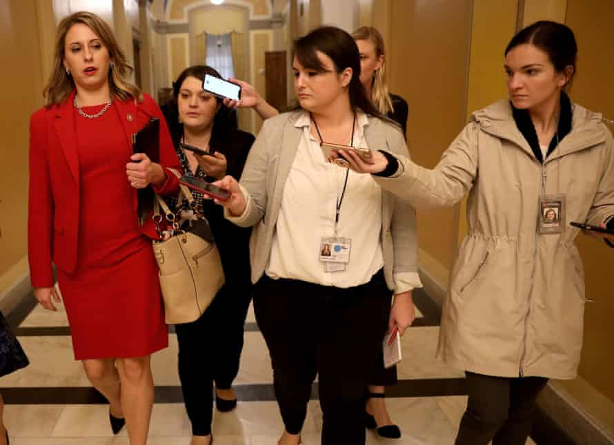 Katie Hill answers questions from reporters following her final speech on the House floor in Washington DC, on 31 October 2019.