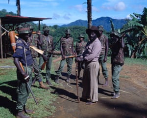 Bougainville Revolutionary Army leader Francis Ona, barefoot and wearing a bush hat, in 1994 during the decade-long civil war in the archipelago.