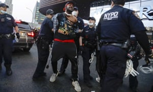 Police arrest a protester during a rally at the Barclays Center