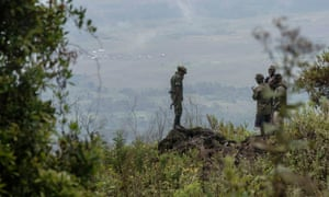 Rangers stand near a security post in the Virunga national park