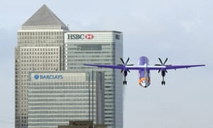 A Flybe plane takes off at London City Airport near Canary Wharf, east London.