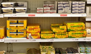 Shelves of butter in supermarket
