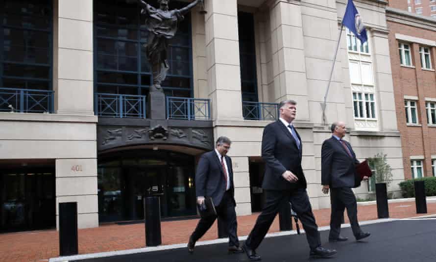 Members of the defense team for Paul Manafort leave federal court in Alexandria, Virginia Tuesday.